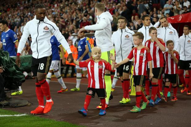 The Northern Echo: MASCOT: Bradley Lowery  appears as mascot alongside Sunderland captain Jermain Defoe during their match against Everton at the Stadium of Light. Picture: CHRIS BOOTH