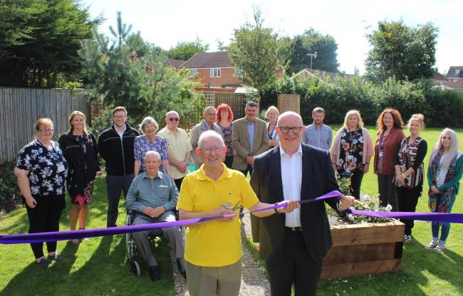 LAUNCH: Andy Powell, Broadacres' director of customer services, cuts the ribbon to officially declare the path open with Rivendale resident Brian Land