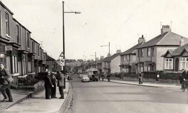 "The Northern Echo: CHANGING TIMES: Byerley Road in Dcember 1960. On the left is a sign for Senior Service cigarettes which, apparently, satisfy. Then there's the old school sign, warning drivers of the proximity of Timothy Hackworth. A bus – with ""duplicate"""