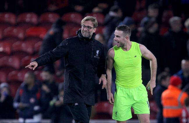 Jurgen Klopp celebrates with Jordan Henderson in the wake of Liverpool's 3-0 win at Middlesbrough