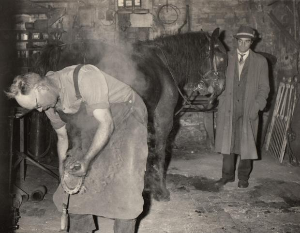 The Northern Echo: FORGING AHEAD: Bowburn blacksmith Mr R Greathead at work in the forge in October 1963 when it was confirmed that the new motorway – the A1(M) – would require the demolition of the centuries-old forge. By coincidence, 50 years ago today, the Darlington