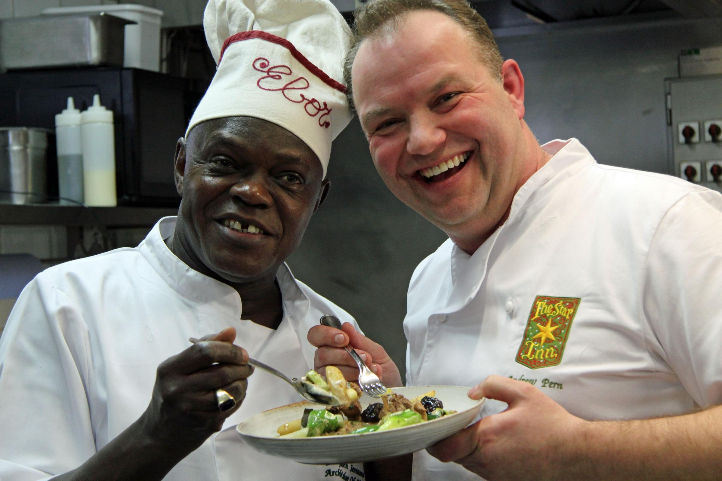 Archbishop Sentamu and Andrew Pern with a pheasant dish