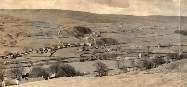 The Northern Echo: WONDERFUL PANORAMA: That is Ireshopeburn down below, with the Wear in the foreground and the railway running along its bank. The picture was taken on April 11, 1964, when the last snow was still in the gills on the tops. Snaking up the dale on the left is