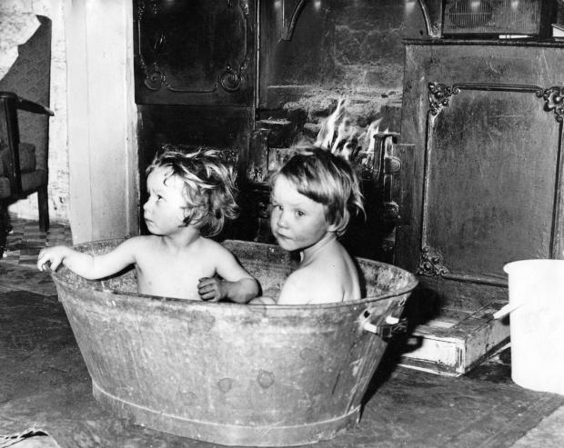 The Northern Echo: LAVEN TIN: Two kids in a bath at Gurney Valley, near Bishop Auckland, in January 1974. The range on which the water was heated is behind and they are in a tin bath so, to be perfectly correct, the laven tin is actually the bucket on the right of the pictu