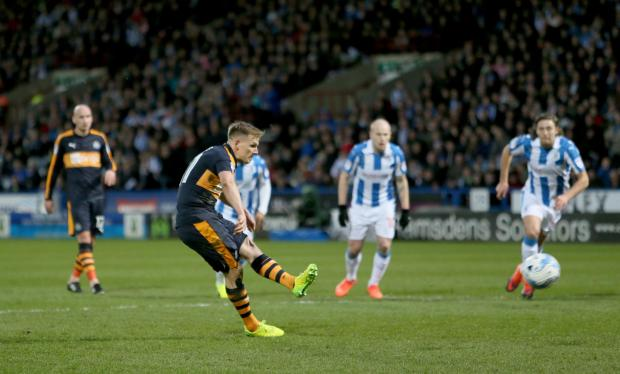 The Northern Echo: OPENER: Newcastle United's Matt Ritchie scores from the spot. Picture: RICHARD SELLERS /PA Wire