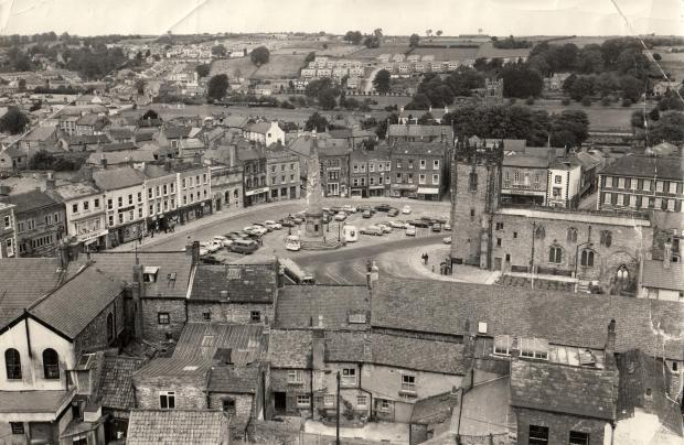 The Northern Echo: Richmond Market Place from the castle in August 1974, with the 1771 obelisk that was erected over a 12,000 gallon reservoir. The cricket club only has a small wooden pavilion, and the houses of Prior and Bolton avenues are just being built on the hillside
