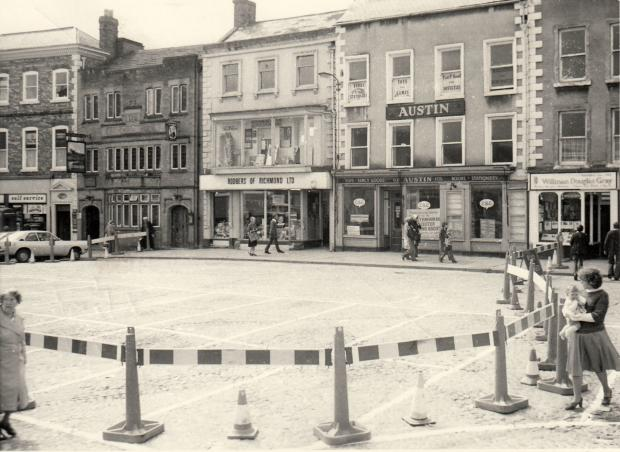 The Northern Echo: DANGEROUS BUILDING: The top of Richmond Market Place fenced off because Austin's toyshop had partially collapsed during renovation in August 1978. It looks to have pulled through alright, though, as does Rodbers of Richmond on its left, which has lost