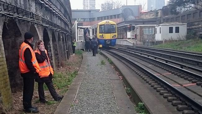 Hundreds of rail passengers forced to walk along tracks after power