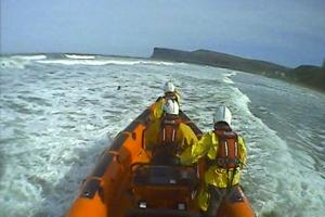 RESCUE: The Redcar RNLI crew rescue a woman in the sea at Saltburn Picture: REDCAR RNLI