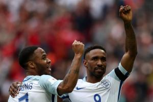 STILL GOING STRONG: Jermain Defoe celebrates his weekend goal for England with team-mate Raheem Sterling