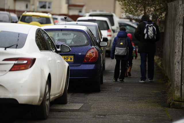 Parents parking partly on the footpath outside a school in Glasgow, Scotland. Picture: Jamie Simpson/Herald & Times