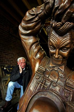 Sculptor Bob Olley with his statue of Stan Laurel. Picture Stuart Boulton