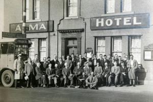 PUB OUTING: A marvellous picture from about 1930 of an Alma awayday, led by Alf Common. He can be seen third from the left on the first chair, and his name is above the door. There's a United bus timetable on the right and an Express Motors noticeboar