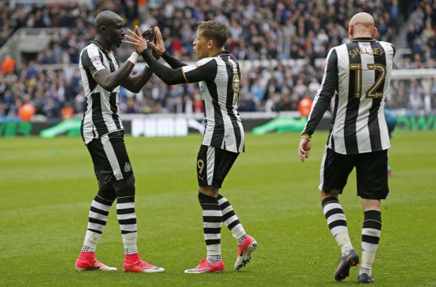 The Northern Echo: TOGETHER: Newcastle United's Dwight Gayle celebrates with his team-mates