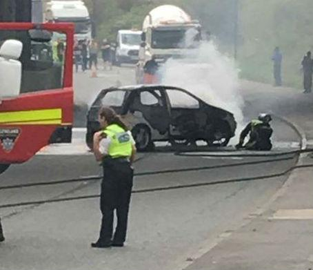 FIRE: The car fire on Tees Dock Road, Middlesbrough is put out. Picture: INCIDENTS ON TEESSIDE