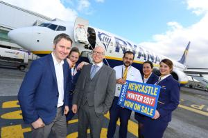 ROUTES: SERVICES: Robin Kiely, left, with Leon McQuaid, Newcastle Airport's aviation development manager, and Ryanair cabin crew