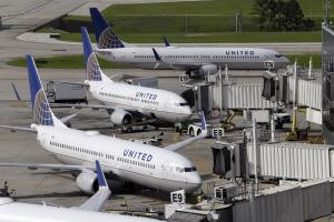 Doctor dragged off United flight settles case with airline
