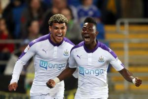 Newcastle United's Christian Atsu (right) celebrates scoring his side's first goal of the game with DeAndre Yedlin during the Sky Bet Championship match at The Cardiff City Stadium, Cardiff. PRESS ASSOCIATION Photo. Picture date: Friday April 28,