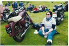 BREAK: First female motorcycle finisher Rachael Houchin takes a welcome break at Bainbridge Village Green, alongside her Ariel 350cc