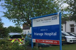A sign outside Friarage Hospital, Northallerton, North Yorkshire, where Chantelle Page, 28, who was pregnant with twins, was treated after she collapsed at home. Picture: PA