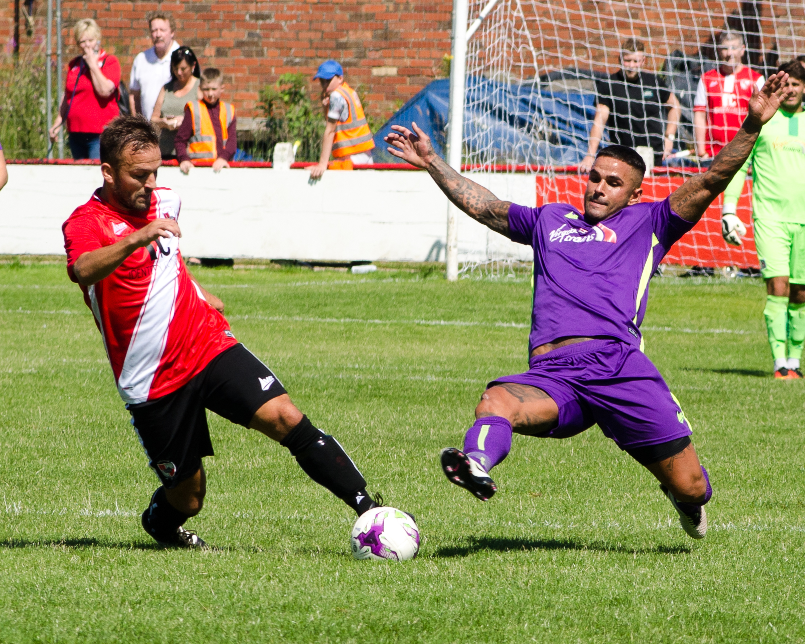 AT A STRETCH: Leon Scott, Darlington's only outfield player to play the entire 90 minutes on Saturday, attempts to tackle Shildon's Lewis Dodds. Picture: NICK BURTON
