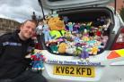 BEARS: Sergeant Dave Clarke with some of the 'trauma teddies' knitted in response to the appeal