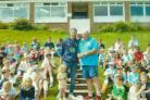 Graham Onions, left, with Durham City Cricket Club president Brian Stone and some of the 100 boys and girls who attended a junior cricket festival
