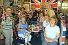 PATRIOTIC: Anita Atkinson, back row first on left, with members of Frosterley Women's Institute in her royal themed museum at her home near Fir Tree