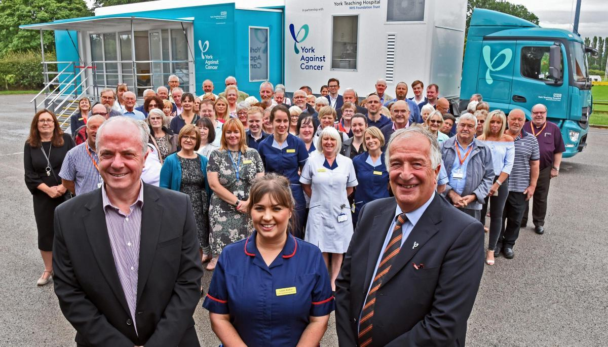 CHEMO: Trust chief executive Patrick Crowley, nurse Lizzie Walker, and Steve Levison, from York Against Cancer, at the launch of the mobile chemo unit at Malton Rugby Club