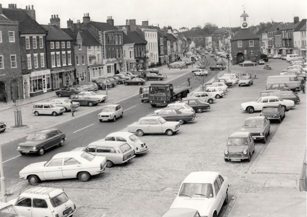 The Northern Echo: CROWDED PLACE: Even in May 1975 there was traffic chaos in Yarm High Street. Cars are pulling out by the Town Hall but are stuck in the road because the pedestrian crossing lights are changing, and that illegally stopped coal wagon is forcing vehicles to