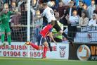 York City's Amari Morgan-Smith and Darlington's David Sayers challenge for the ball. Picture: Gordon Clayton