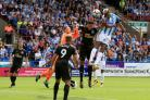 UP IN THE AIR: Huddersfield Town's Steve Mounie directs a header on Rob Elliot's goal on Sunday