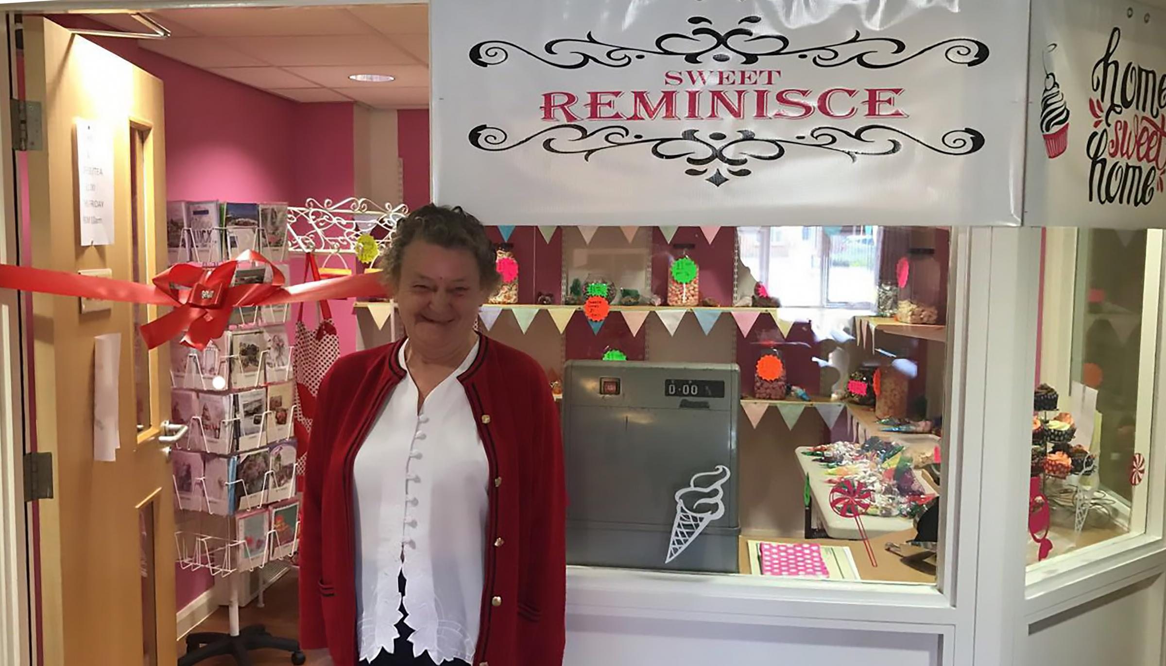 June Brown visiting the shop in Rosemary Court