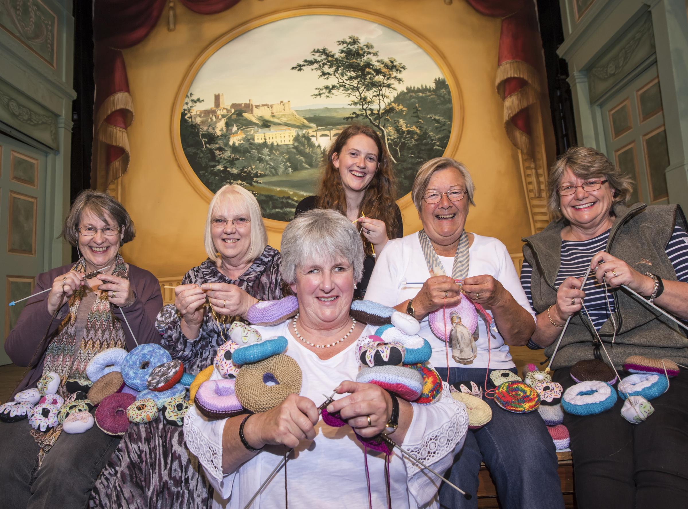 DOUGHNUTS: Volunteers at the Georgian Theatre Royal embark on this year's pantomime knitting campaign. Left to right: Avril Proudlock, Carrie Stephenson, Lynne Kemp, Freya Mawhinney, Jen Capewell and Sue Stephenson.