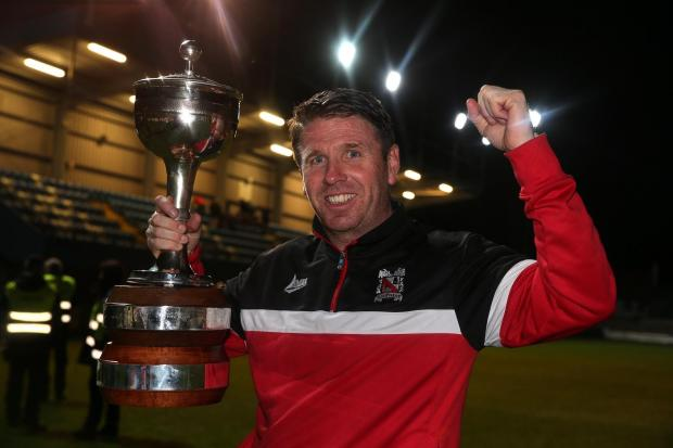 The Northern Echo: Martin Gray with the trophy after Darlington clinched the Evo-Stik Northern Premier League title, the third of their promotions in his time as Quakers' boss. Picture: CHRIS BOOTH