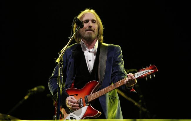 American musician, singer and songwriter Tom Petty, who has died aged 60, performing with the Heartbreakers on the Big Top stage at the Isle of Wight Festival. Picture: PA