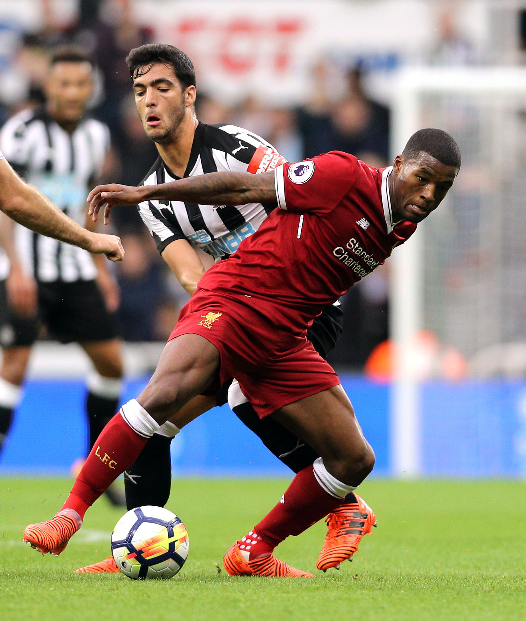 Newcastle United's Mikel Merino and Liverpool's Georginio Wijnaldum (right) battle for the ball Picture: PA
