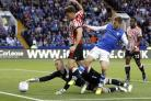 Sheffield Wednesday's Sam Winnall battles for the ball with Sunderland's Billy Jones and goalkeeper Jason Steele, during the Sky Bet Championship match at Hillsborough, Sheffield. PRESS ASSOCIATION Photo. Picture date: Wednesday August 16, 2017. S