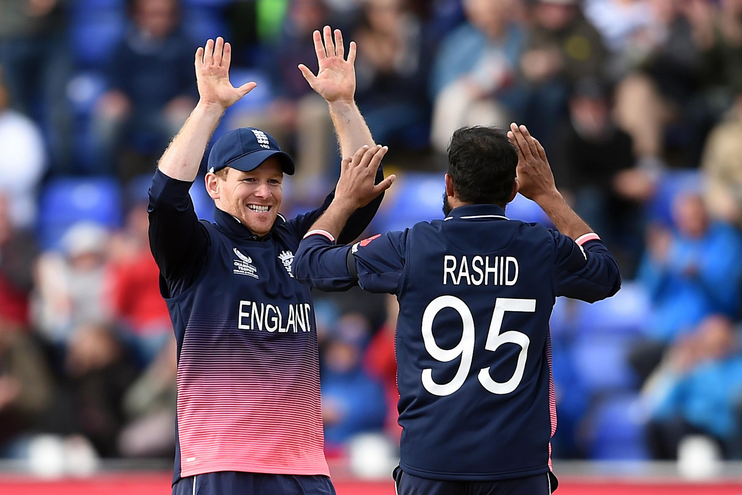England's Eoin Morgan (left) celebrates with Adil Rashid