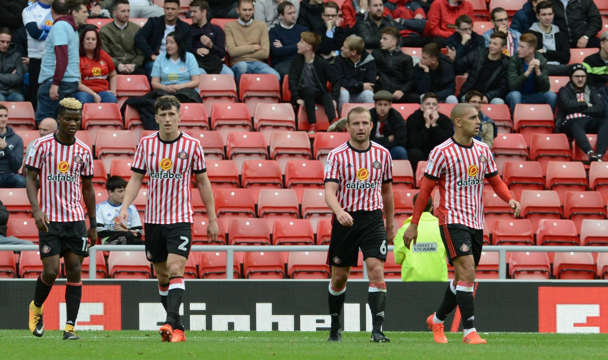 GLUM FACES: Sunderland's players trudge back to the centre-circle after conceding the opening goal in their 1-1 draw with QPR (Picture: North News)