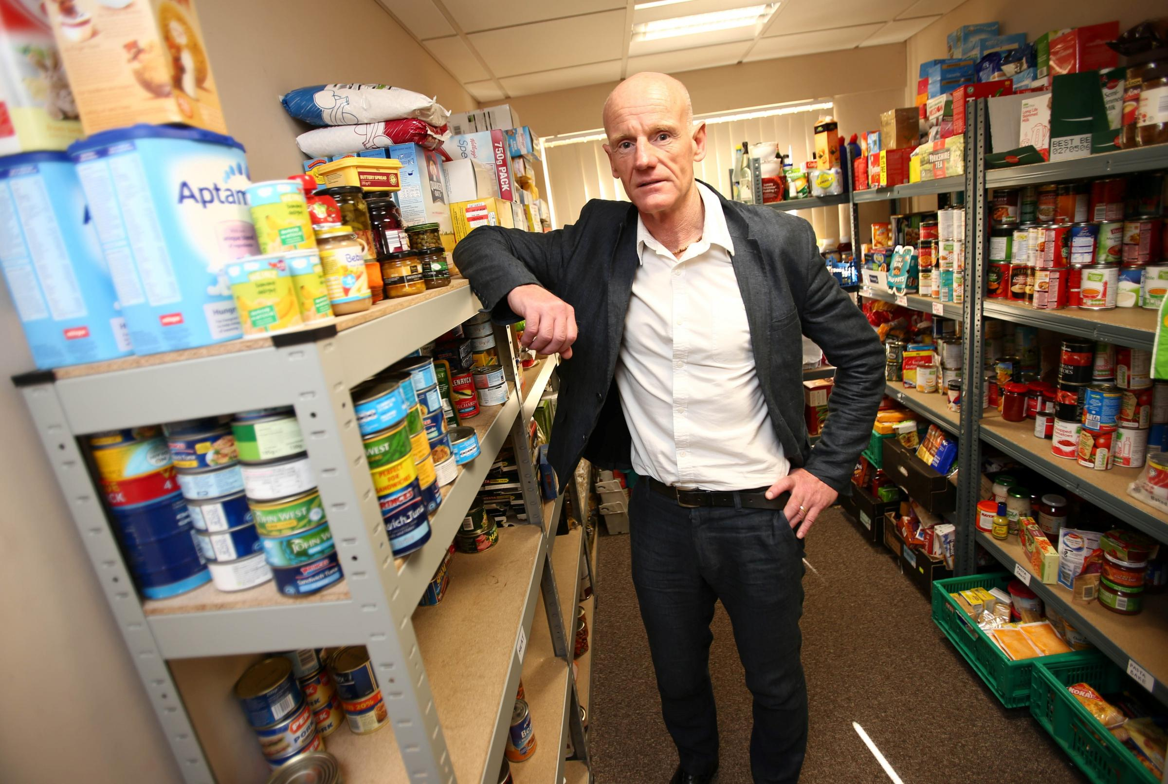 FOOD CRISIS: Malcolm Fallow, Chief Executive of East Durham Trust in the East Durham Feed Project food bank. Picture: TOM BANKS.