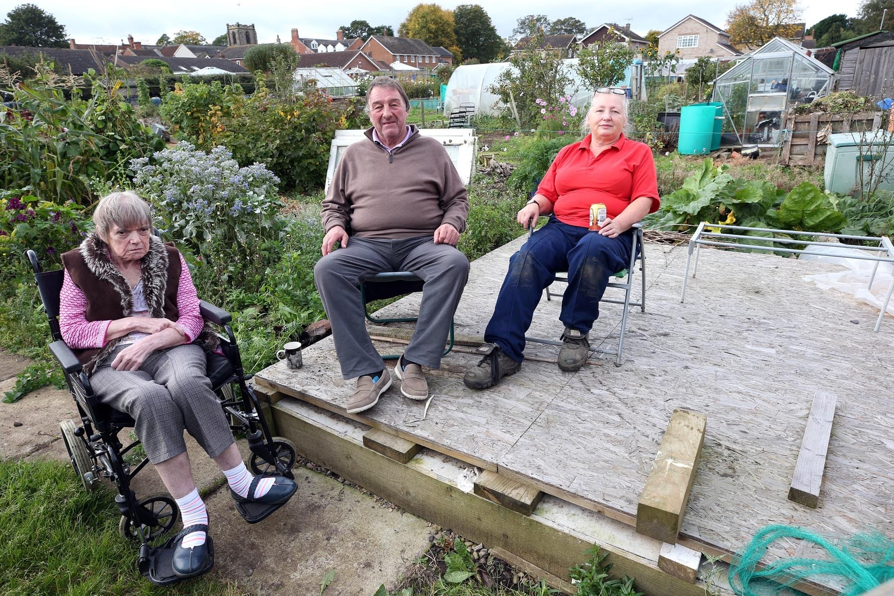 ROW: Residents have been given an eviction notice after complaining about being refused permission to build a summer house for disabled people to use. At the Hurworth allotments are Susan and John Middlemiss and Maureen Powles Picture: CHRIS BOOTH