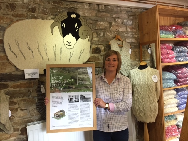 PROJECT: Gillian Whitehead at Swaledale Woollens in Muker receives a cowhouse poster Photo: YDNPA