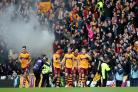 Louis Moult celebrates with his Motherwell team-mates and fans after scoring the first goal