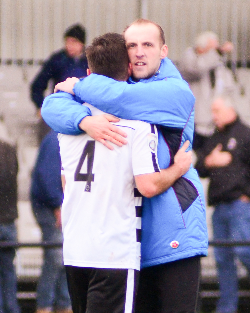 PROUD: Temporary managers Phil Turnbull (left) and Gary Brown embrace at full-time. Picture: NICK BURTON