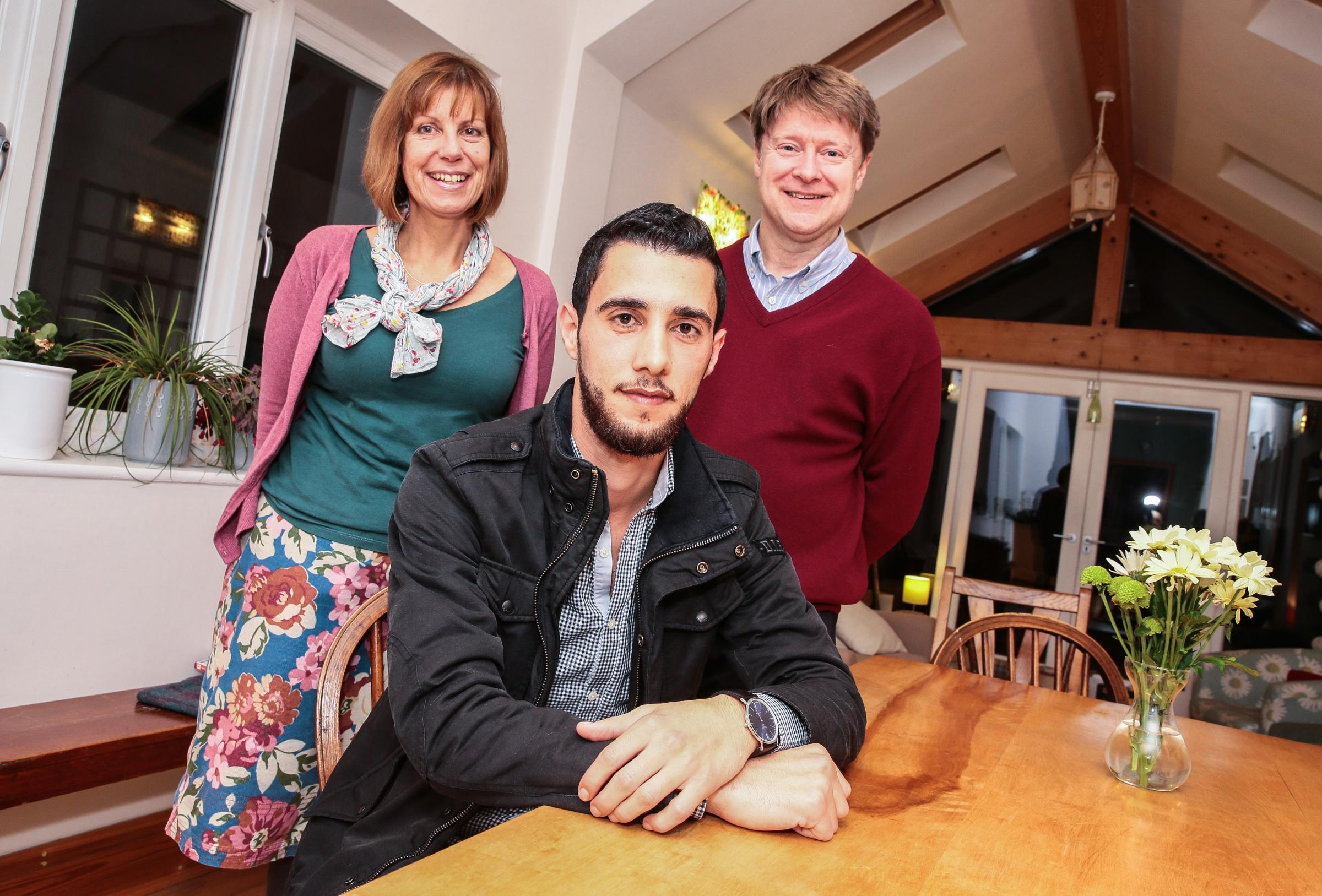 FRIENDSHIP: Fran and Martin Wood with Mouhyedin Alkhalil. Picture: Sarah Caldecott