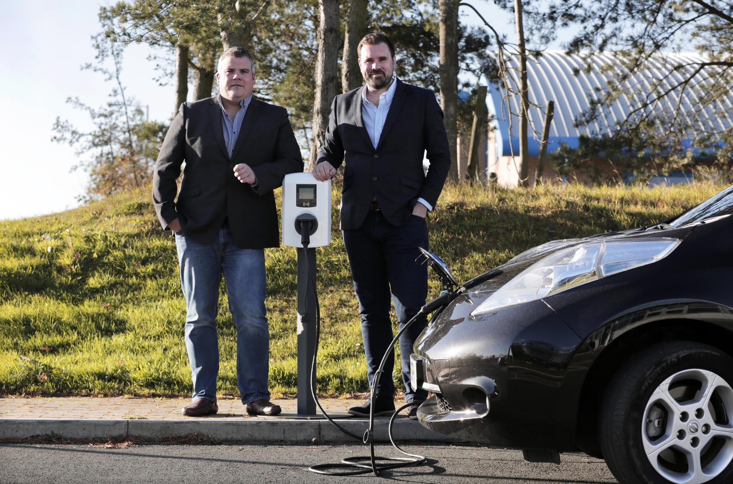 PLANS: Elmtronics' technical director Anthony Piggott, left, with commercial director Dan Martin and one of the recharging units at the company's Consett base