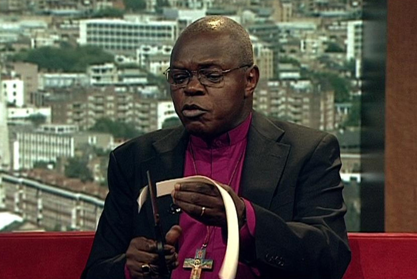 Archbishop of York Dr John Sentamu, appearing on BBC1's Andrew Marr show in 2007, cuts up his dog collar,  in protest at the rule of Zimbabwean President Robert Mugabe. Picture: BBC TV/PA