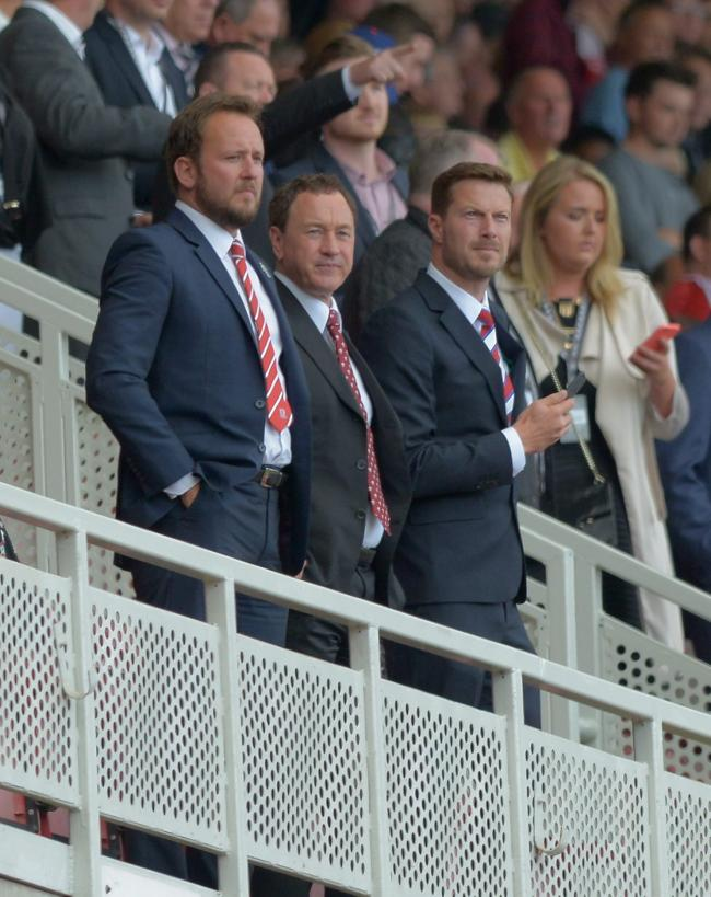 TRANSFER BUSINESS: The Middlesbrough hierarchy watch on from the directors' box at the Riverside