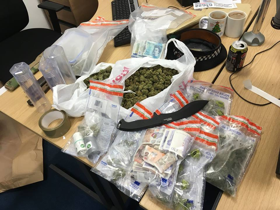 Weapons, drugs and cash seized as police raid house